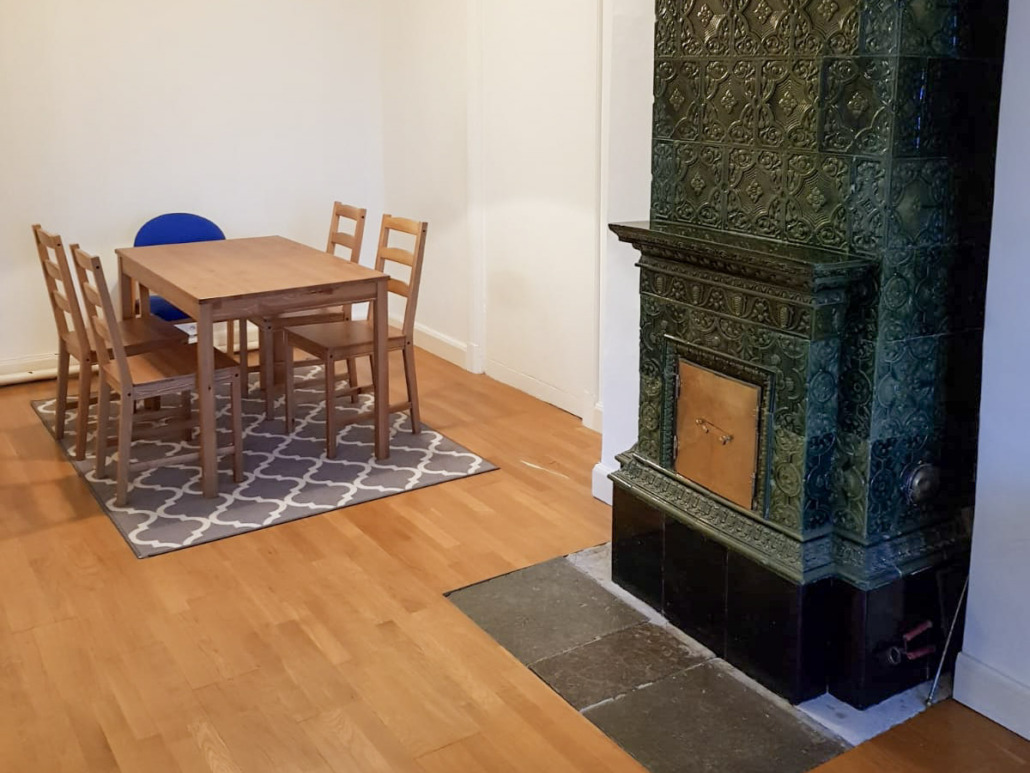 Tiled stove and dining table in Uppsala